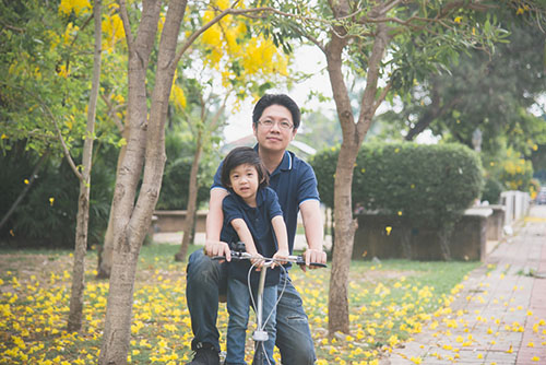 Asian father and son riding bicycle.jpg